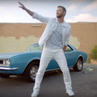 Justin Timberlake in front of car